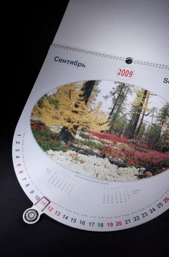 """Настенный перекидной календарь для компании """"Нефтересурсы"""" с вырубкой и поворотным курсором"""
