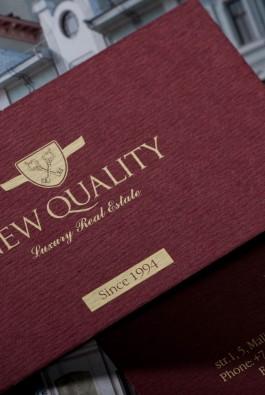 визитки риэлтерской компании New Quality